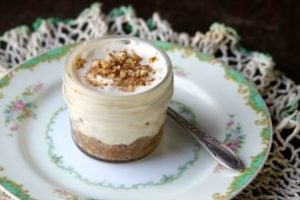 low carb caramel pecan cheesecake on a green and white vintage plate - feature image
