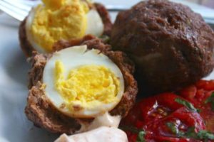 Baked Scotch eggs are easier than you might think and have less than one carb for two of them! Lots of protein, too! Lowcarb-ology.com