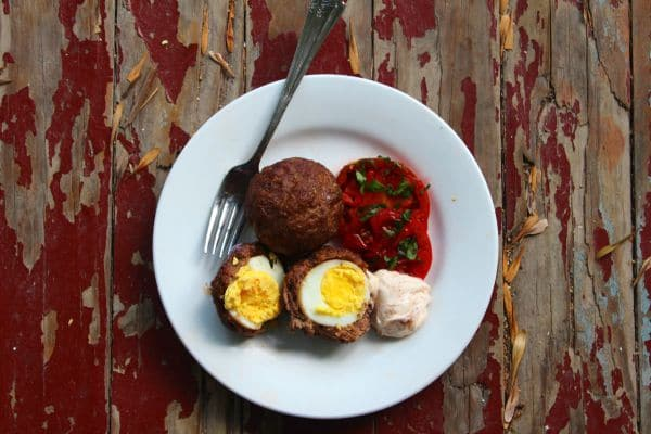 Baked Scotch Eggs are Tex Mex style in a spicy, smoky ground beef mixture. Lowcarb-ology.com