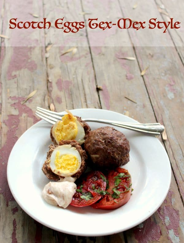 Baked Scotch Eggs are covered in a Tex-Mex seasoned ground beef... so ...