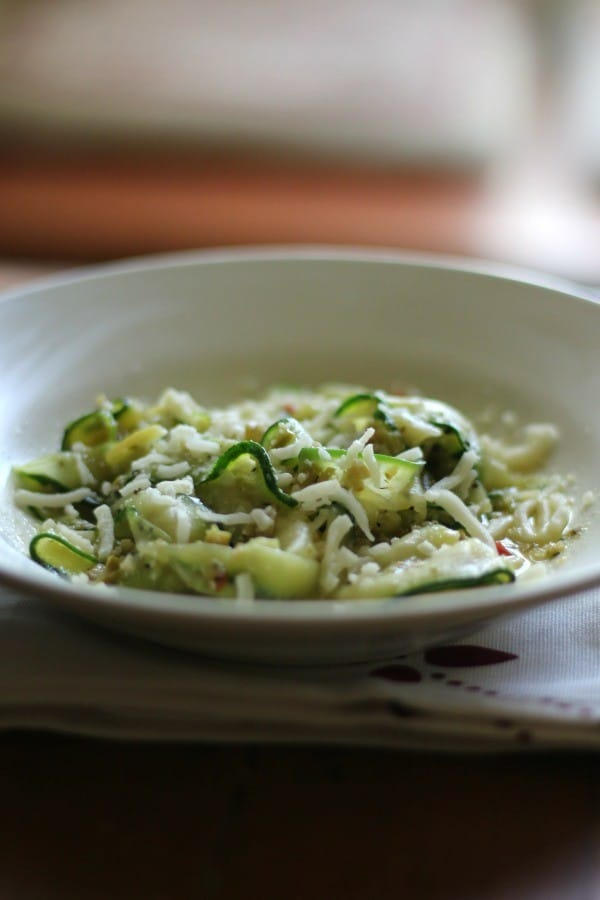 This low carb zucchini pappardelle is covered in a light, garlicky olive oil. Quick and easy! From Lowcarb-ology.com