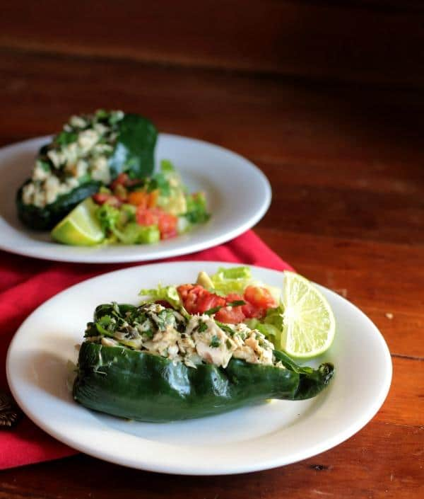 These low carb tuna stuffed poblano peppers are full of Tex-Mex flavor. Perfect lunch on the go! From Lowcarb-ology.com