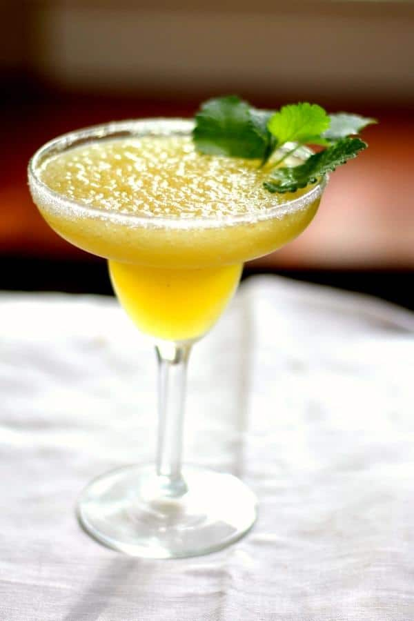 Low Carb and sugar free Tropical Margarita Slush is a guilt-free summer cocktail. From Lowcarb-ology.com
