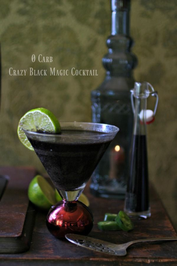 An easy, rum based, black colored cocktail that will be the hit of your Halloween Parties. From Lowcarb-ology.com