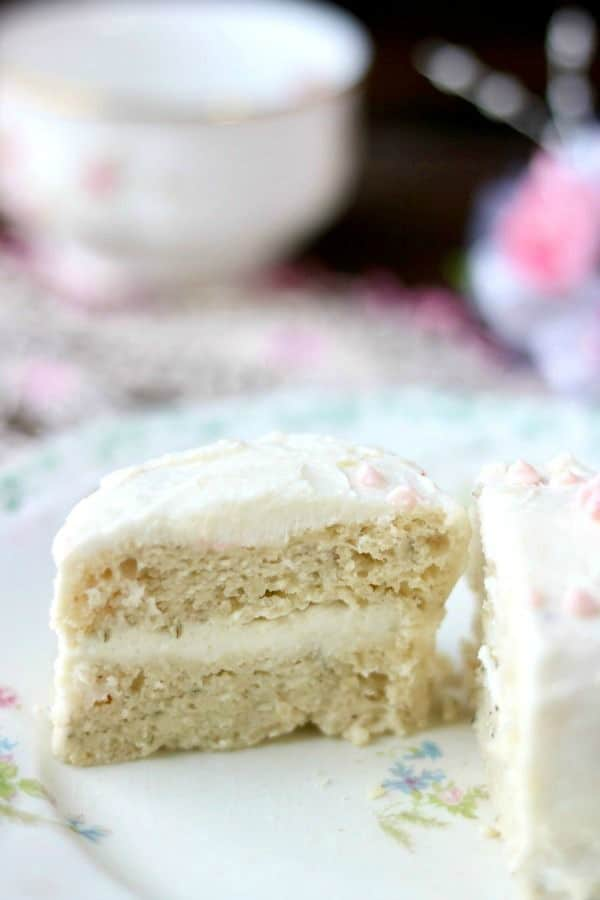 This easy low carb cake recipe is light and fluffy with a creamy white chocolate almond frosting - from Lowcarb-ology.com