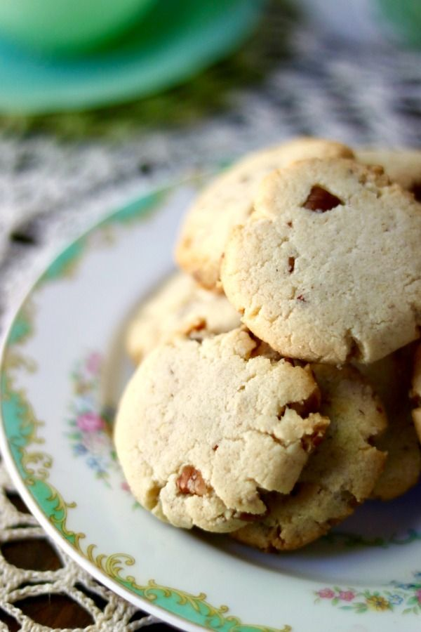 Closeup of low carb butter pecan shortbread cookies on an antique plate