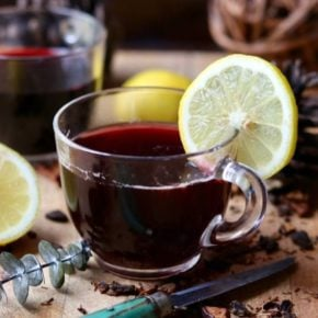 Recipe image, low carb hot mulled wine with a lemon slice on the edge.