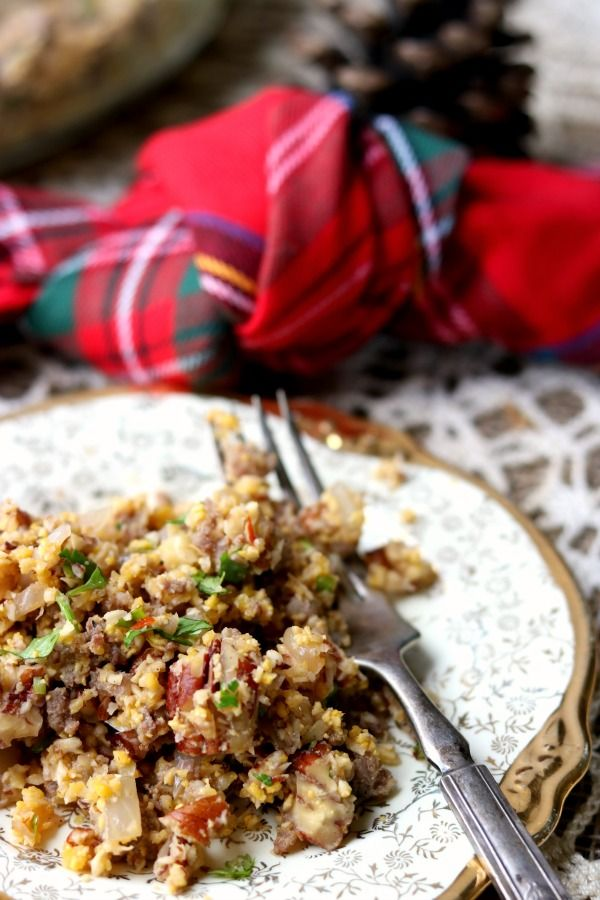 Close up of low carb stuffing recipe with a fork on the plate and red plaid napkin in the background.