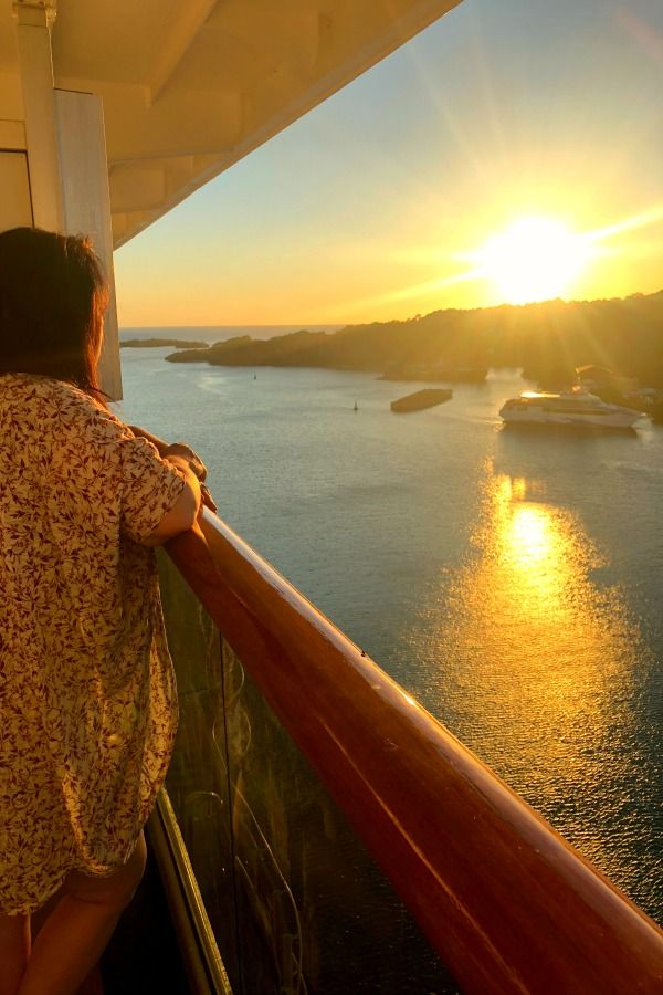 Marye Audet, Author of Tropical Mule Recipe, Standing on the Balcony of a Cruise Ship at Sunset