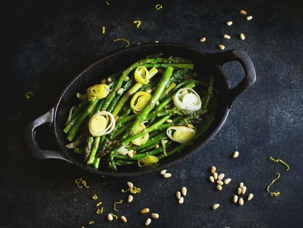 leek and asparagus salad in a dark dish