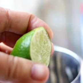 Next step is squeezing the lime and lemon into the shaker