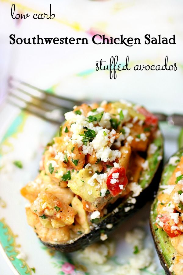 Southwestern chicken salad stuffed avocados are sprinkles with white queso fresco cheese.
