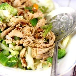 Feature image - Hunan Chicken salad has pieces of cooked chicken over a bed of salad greens and crunchy vegetables