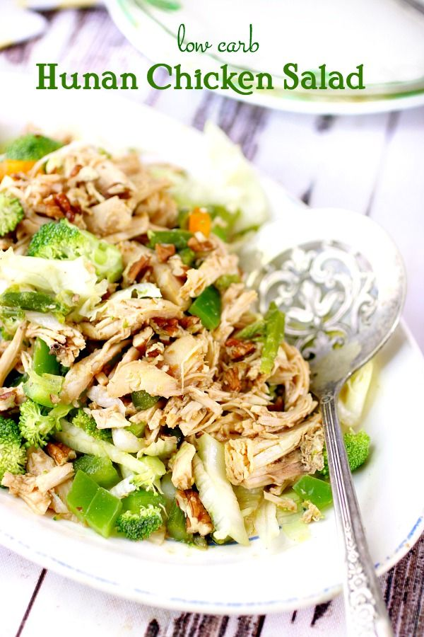 Title image for Hunan Chicken Salad -served up on a white platter with a silver serving spoon lying next to it.