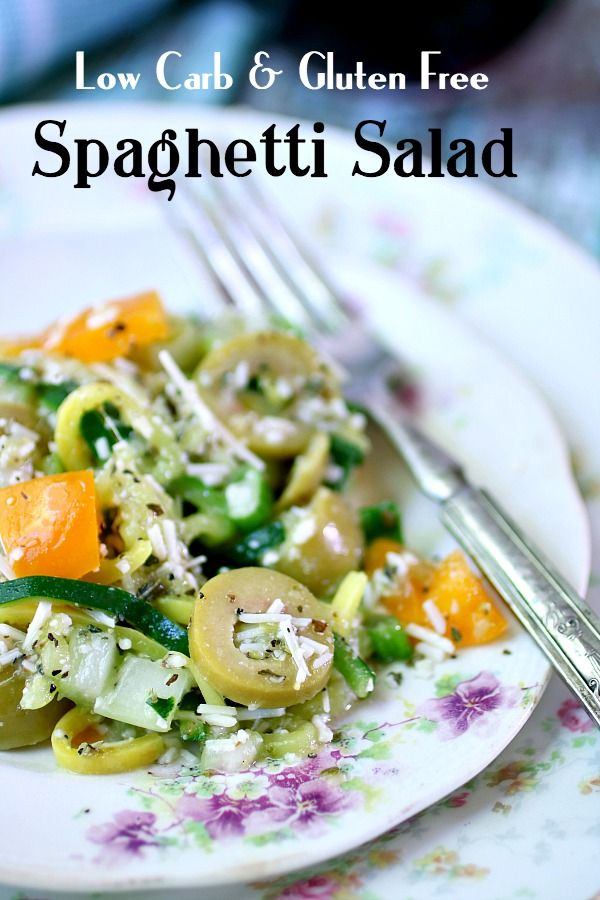 Low carb spaghetti salad made from spiralized zucchini is on a vintage white plate - title image