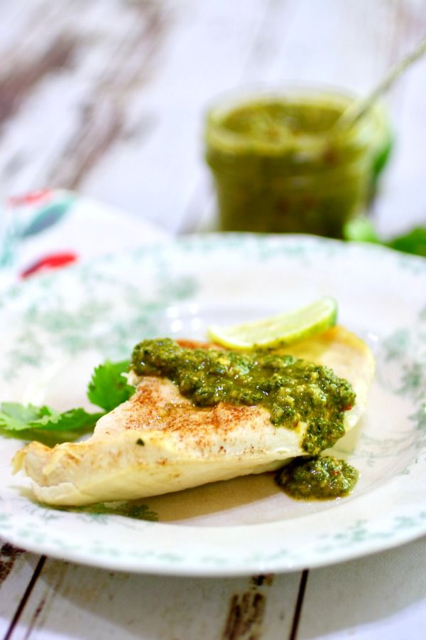 Homemade chimichurri steak sauce spooned over grilled chicken breast