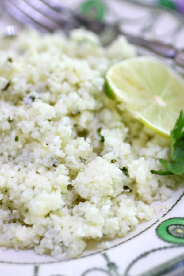 A very close view of cilantro lime rice to that the reader can see the fluffiness of the dish.