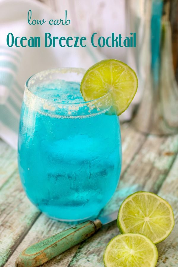 Bright blue low carb cocktail garnished with a lime. Title image