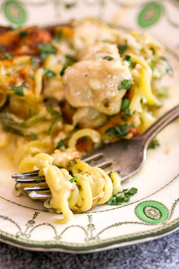 Low carb chicken tetrazzini zoodles wrapped around a fork -ready to eat