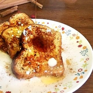 Low carb syrup being poured on this easy low carb cinnamon rench toast.