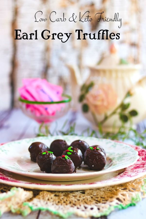 Chocolate truffles on a plate with a tea kettle in the background